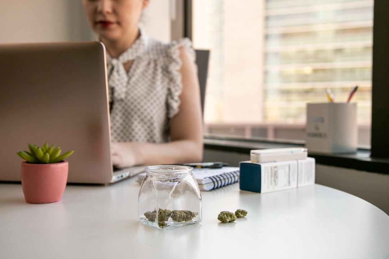 Woman researching about microdosing medical marijuana using a laptop.