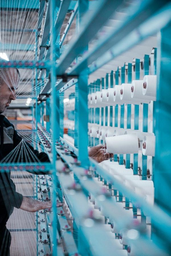 man-in-black-jacket-standing-beside-blue-metal-machine-3544567 (2).jpg